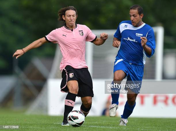 Edgar Barreto of Palermo and Stefano Attardi of Selezione Alta Val Venosta compete for the ball during a preseason friendly match between US Citta di...