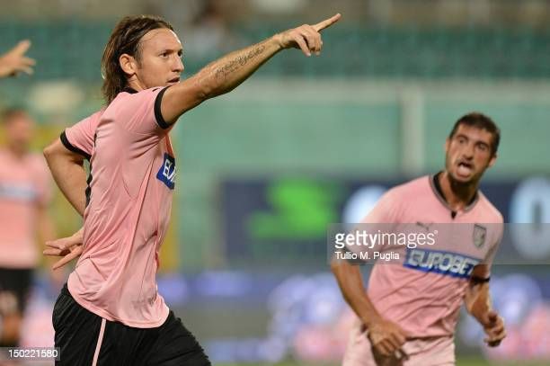 Edgar Barreto of Palermo celebrates with team mate Franco Brienza after scoring the opening goalduring the preseason friendly match between US Citta...