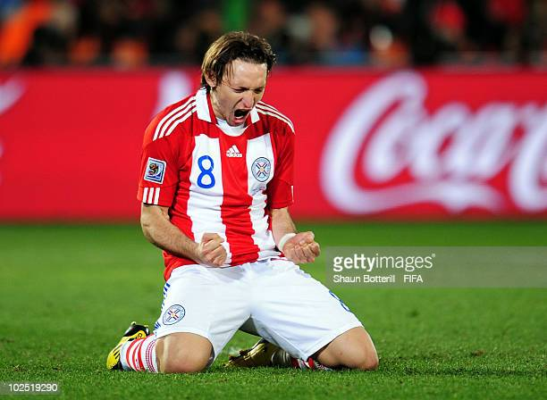 Edgar Barreto of Paraguay celebrates scoring a penalty in extra time during the 2010 FIFA World Cup South Africa Round of Sixteen match between...