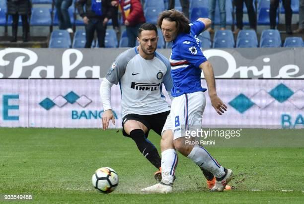 Edgar Barreto of Sampdoria and Danilo D'Ambrosio of Inter during the serie A match between UC Sampdoria and FC Internazionale at Stadio Luigi...