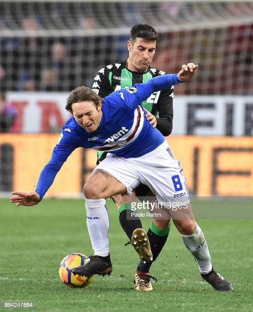 Edgar Barreto of Sampdoria and Federico Peluso of Sassuolo during the Serie A match between UC Sampdoria and US Sassuolo at Stadio Luigi Ferraris on...