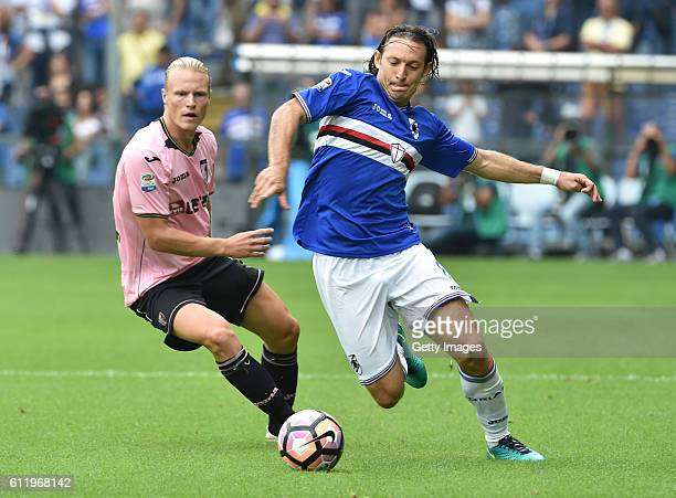 Edgar Barreto of Sampdoria is challenged by Oscar Hiljemark of Palermo during the Serie A match between UC Sampdoria and US Citta di Palermo at...