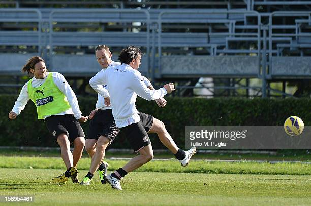 Edgar Barreto Steve Von Bergen and Salvatore Aronica of Palermo in action during a training session at Tenente Carmelo Onorato Sports Center on...