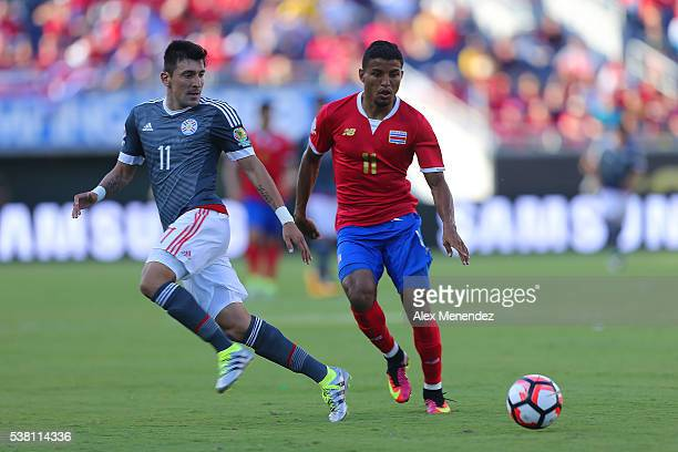 Edgar Benitez of Paraguay and Johan Venegas of Costa Rica watch a loose ball during the 2016 Copa America Centenario Group A match between Costa Rica...