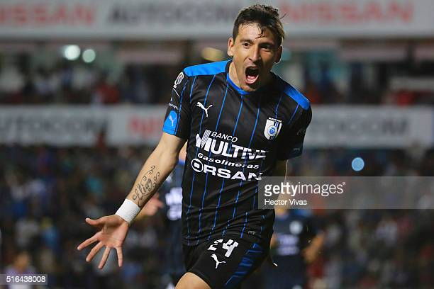 Edgar Benitez of Queretaro celebrates after scoring the first goal of his team during the 11th round match between Queretaro and Chiapas as part of...