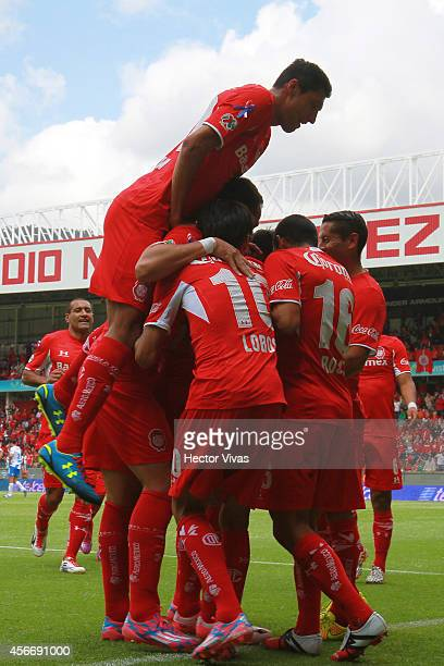 Edgar Benitez of Toluca celebrate with teammates after scoring the opening goal of his team during a match between Toluca and Puebla as part of 12th...