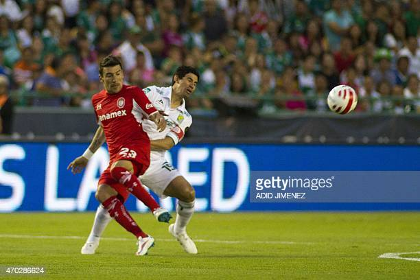 Edgar Benitez of Toluca vies for the ball with Jonny Magallon of Leon during their Mexican Soccer Clausura 2015 tournament in Leon Guanajuato State...