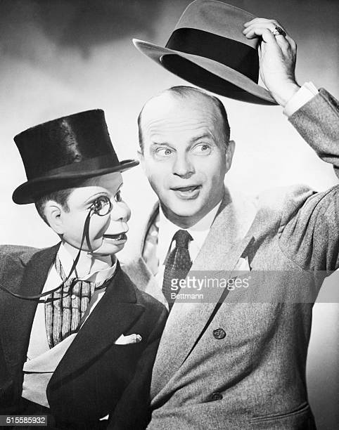 Edgar Bergen and Charlie McCarthy seated