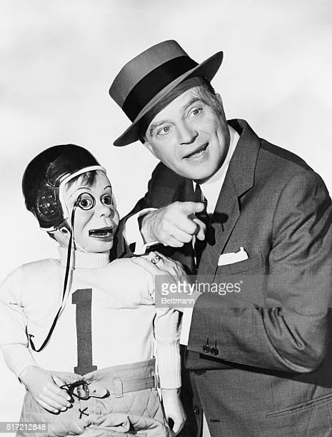 Edgar Bergen and Charlie McCarthy wearing football uniform enjoy a nice talk