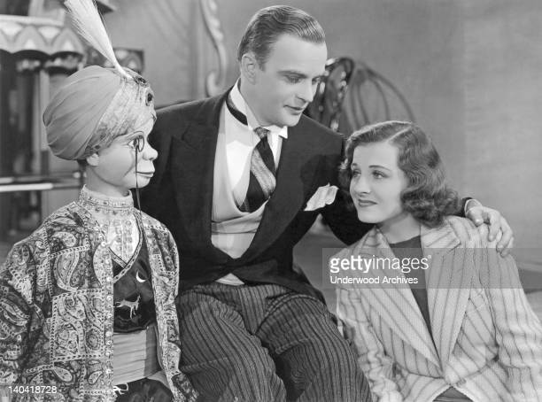 Edgar Bergen Charlie McCarthy and Constance Moore appear in the 1939 Hollywood California film 'You Can't Cheat An Honest Man'