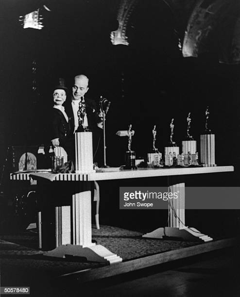 Edgar Bergen performing with puppet Charlie McCarthy at Academy Awards presentation