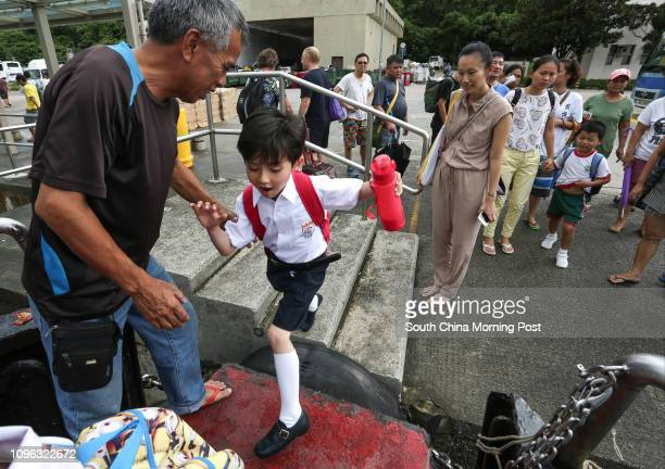 Edgar Bouteiller and his mum Nikki Bouteiller on their way to Holy Family School in Peng Chau from Discovery Bay 01SEP16 SCMP / Jonathan Wong