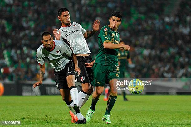 Edgar Castillo of Atlas and Luis Angel Mendoza of Santos fight for the ball during a match between Santos Laguna and Atlas as part of 7th round...