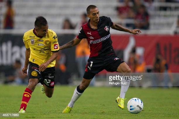 Edgar Castillo of Atlas fights for the ball with Efren Mendoza of UdG during a match between Atlas and Leones Negros as part of 5th round Apertura...