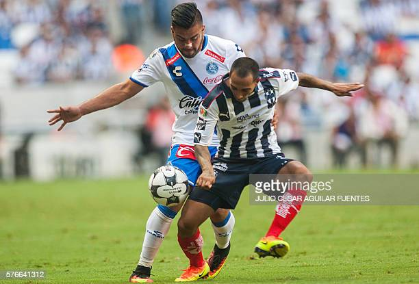 Edgar Castillo of Monterrey vies for the ball with Pedro Canelo of Puebla during the Mexican Apertura 2016 tournament football match in Monterrey...
