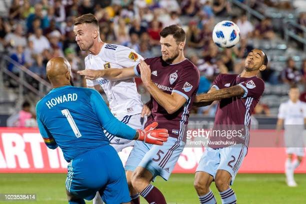Edgar Castillo of the Colorado Rapids avoids a blocked ball by teammate Tim Howard at Dick's Sporting Goods Park on August 25, 2018 in Commerce City,...