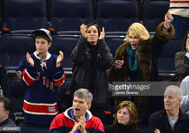 Edgar Cooper Endicott Melissa Rivers and Joan Rivers attend the Vancouver Canucks vs New York Rangers game at Madison Square Garden on November 30...