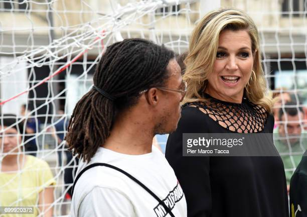 Edgar Davids Aron Queen Maxima of The Netherlands attend a football clinic for integration organized by Italian Football Federation at Piazzetta...