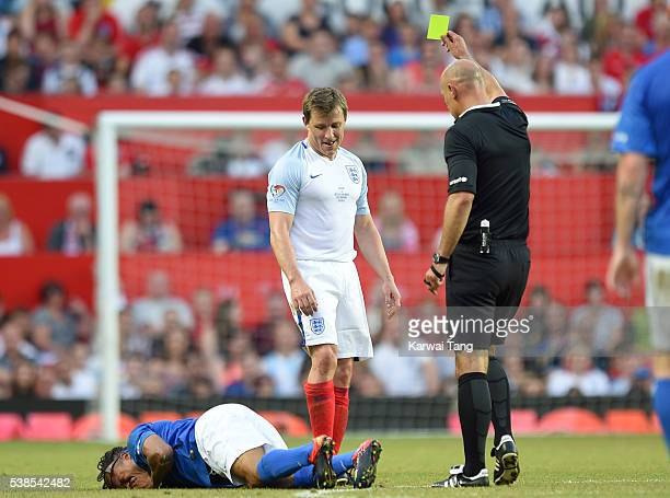 Edgar Davids gets tackled by Ben Shephard during Soccer Aid 2016 at Old Trafford on June 5 2016 in Manchester United Kingdom