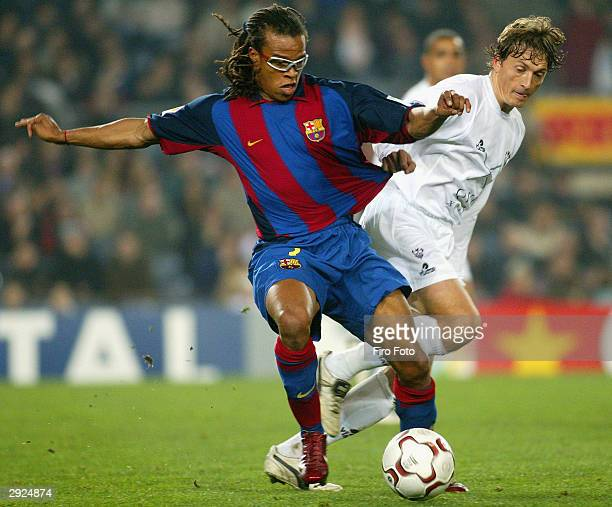 Edgar Davids of Barcelona and Mikel of Albacete in action during the La Liga match between FC Barcelona and Albacete played at the Nou Camp February...