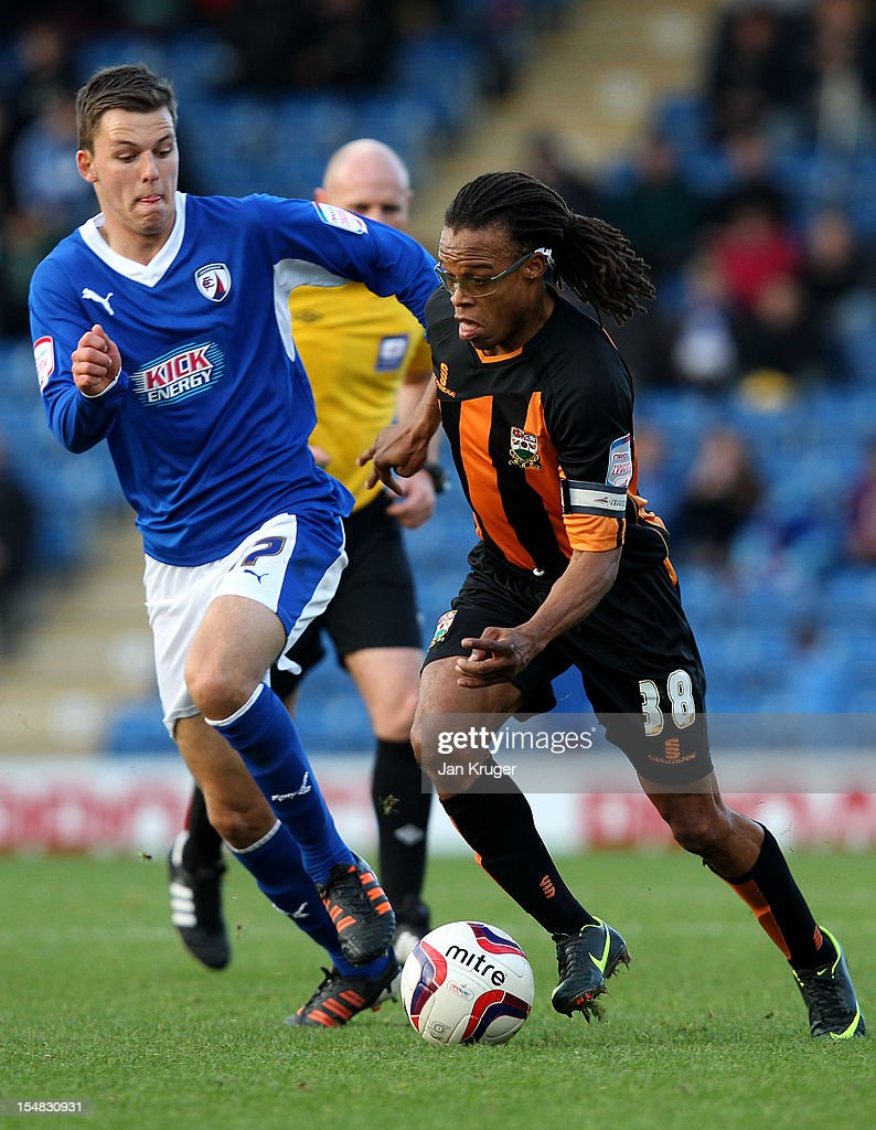 Edgar Davids of Barnet FC battles with Chris Atkinson of Chesterfield during the npower League Two match between Chesterfield and Barnet at Proact Stadium on October 27, 2012 in Chesterfield, England.