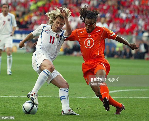 Edgar Davids of Holland clashes with Pavel Nedved of the Czech Rep scores the first goal during the UEFA Euro 2004, Group D match between Holland and...