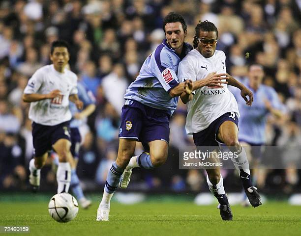 Edgar Davids of Tottenham Hotspur holds off the challenge of Jeff Smith of Port Vale during the Carling Cup Fourth Round match between Tottenham...