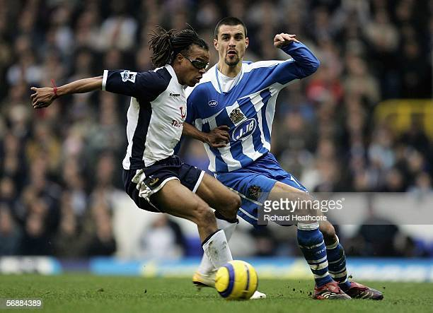 Edgar Davids of Tottenham tussles with Paul Scharner of Wigan during the Barclays Premiership match between Tottenham Hotspur and Wigan Athletic at...