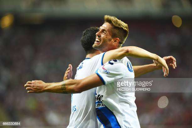 Edgar Duenas and Federico Gonzalez of Puebla celebrate after scoring against Guadalajara during their Mexican Clausura 2017 tournament football match...