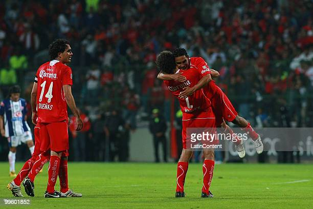Edgar Duenas Diego Novaretti and Jose Manuel Cruzalta of Toluca celebrate victory over Pachuca during a semifinal match as part of the 2010...