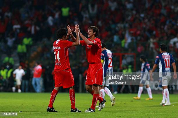 Edgar Duenas Diego Novaretti of Toluca celebrate victory over Pachuca during a semifinal match as part of the 2010 Bicentenary Tournament at Nemesio...