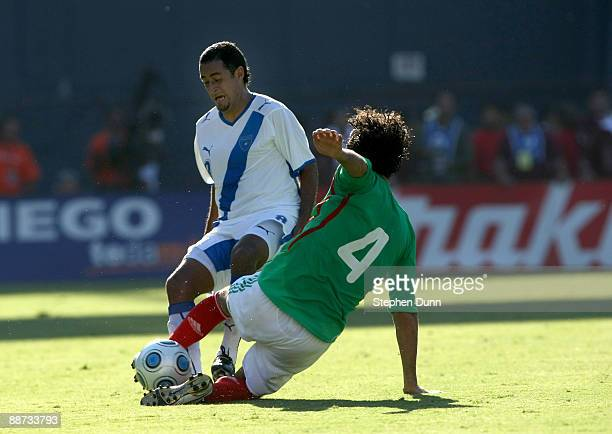 Edgar Duenas of Mexico tackels the ball away from Luis Rodriguez of Guatemala in an international friendly match at Qualcomm Stadium on June 28 2009...