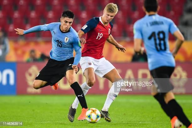 Edgar Elizalde of Uruguay U20, Erling Haland of Norway U20, Juan Sanabria of Uruguay U20 during the FIFA U-20 World Cup Poland 2019 group C match...