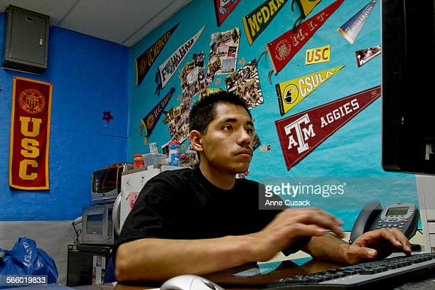 Edgar FloresVillalobos fills out a form for a scholarship as seniors at Garfield High School in Los Angeles fill out FASFA forms in the counseling...