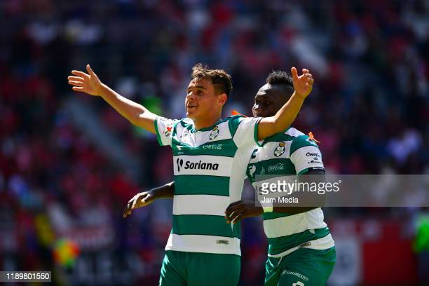 Edgar Games of Santos celebrates after scoring the second goal of his team with teammate Eryc Castillo during the 19th round match between Toluca and...