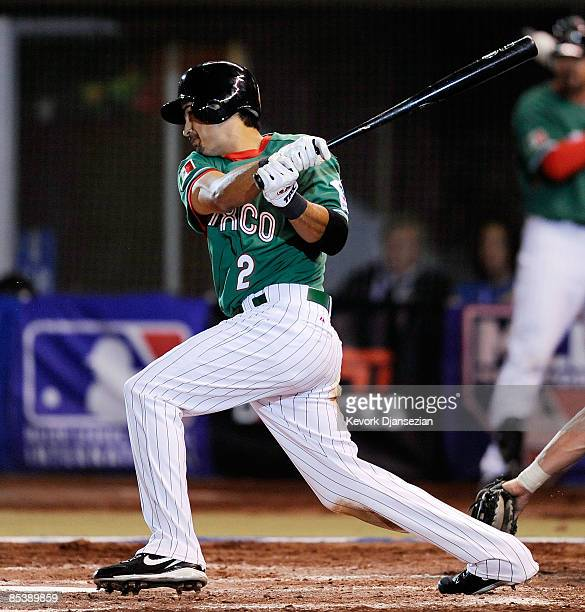 Edgar Gonzalez of Mexico hits a tworun single in the fourth inning against Australia during the 2009 World Baseball Classic Pool B match on March 11...