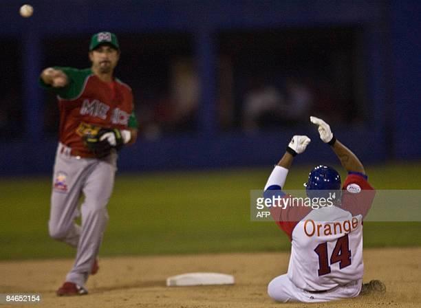 Edgar Gonzalez of Venados de Mazatlan of Mexico puts out Willy Aybar of the Tigres de Licey of Dominican Republic during the Baseball Caribbean...