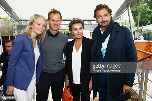 Edgar Grospiron his wife Henri Leconte and his wife Maria Dowlatshahi attend the French Tennis Open Day Fifteen with the Final between Novak Djokovic...