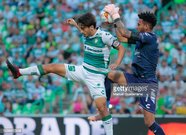 Edgar Hernandez of Veracruz fights for the ball with Javier Abella of Santos during the 10th round match between Santos Laguna and Veracruz as part...