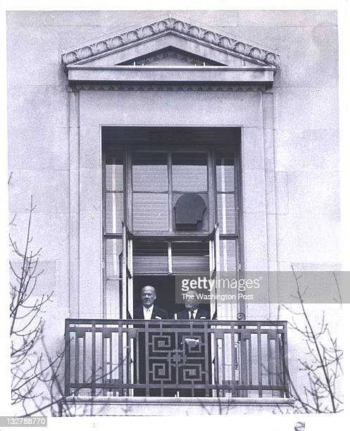 Edgar Hoover and aide Clyde Tolson watch Richard Nixon's inaugural parade from the window of the Justice Department.