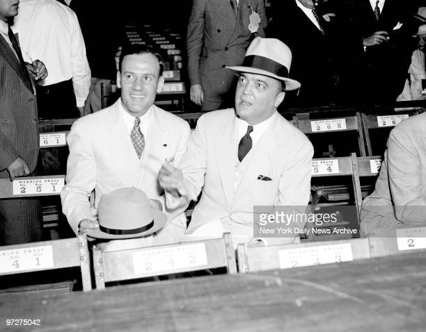 Edgar Hoover and Clyde Tolson attending the Joe Louis - Jack Sharkey fight at Yankee Stadium.