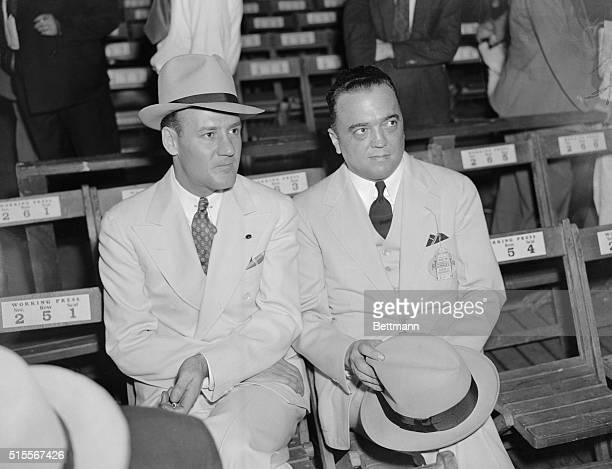 Edgar Hoover, Chief G-Man and his right-hand man, Clyde Tolson, snapped at ringside as they attended the Louis-Sharkey fight, at the Yankee Stadium...