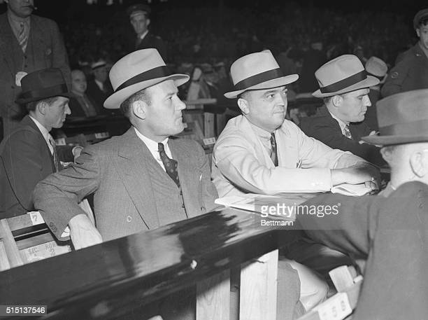Edgar Hoover , chief G-man, with his assistant, Clyde Tolson, as they attended the Louis-Braddock heavyweight championship fight in Chicago, June 22.