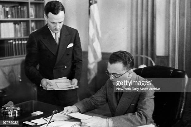 Edgar Hoover , chief of the Division of Investigation of the Department of Justice, and his assistant, Clyde Tolson, working diligently at the...