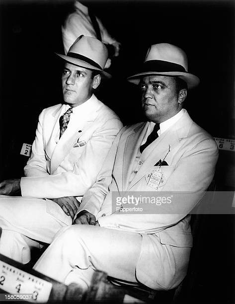 Edgar Hoover, head of the Federal Bureau of Investigaton, and his associate, Clyde Tolson at the Joe Louis and Jack Sharkey fight at Yankee Stadium,...