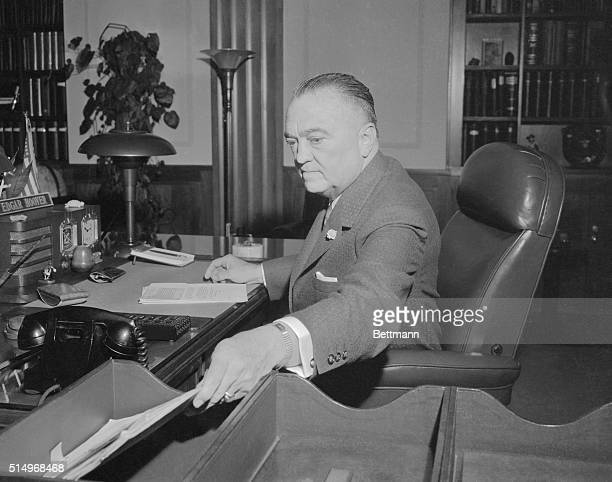 J Edgar Hoover shown at his desk at the Federal Bureau of Investigation here today will have been Director of the FBI for 35 years on Sunday When he...