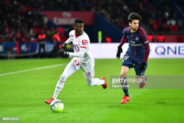 Edgar Ie of Lille and Javier Pastore of PSG during the Ligue 1 match between Paris Saint Germain and Lille OSC at Parc des Princes on December 9 2017...