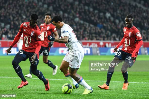 Edgar Ie of Lille and Memphis Depay of Lyon during the Ligue 1 match between Lille OSC and Olympique Lyonnais at Stade Pierre Mauroy on February 18...