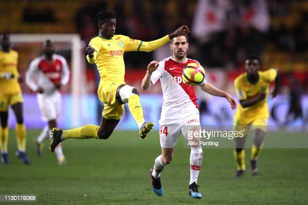 Edgar Ie of Nantes wins the ball infront of Cesc Fabregas of Monaco during the Ligue 1 match between AS Monaco and FC Nantes at Stade Louis II on...