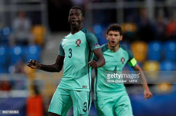 Edgar Ie of Portugal celebrates with team mates after scoring his team's first goal during the UEFA European Under21 Championship Group B match...